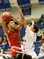 Dover's Keith Davis, left, takes the ball to the basket