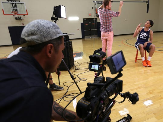 Cameasha Turner records Blake Henderson as he places a microphone over her in preparation for an interview Thursday.