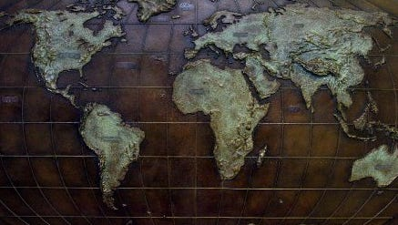 World map by artist Michael Donenefeld.