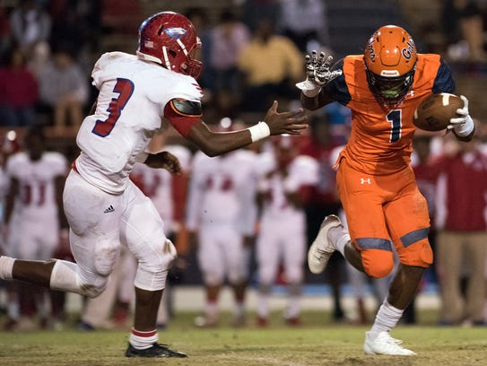 Escambia High School's Jacob Copeland, (No. 1) fights