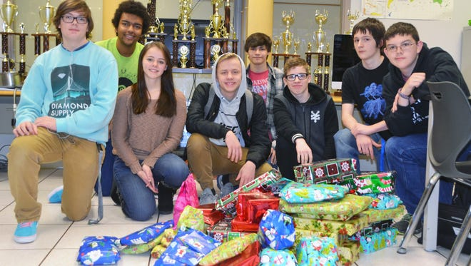D. Russel Lee Career Technology School students, Michael Fugate, Eli Muhammad, Morgan McClurg, Brodie Lykins, Isaac Novak, Vincent King, David Newton, and Jacob Hackman were among several who participated in the Giving Tree project. The teens raised $400 and purchased gifts for 11 children.