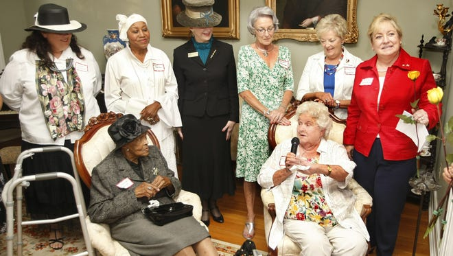 Mabel Steeley, seated right, talks about being the first woman to be elected to the quarterly court, now the County Commission, during a reception honoring the 89th anniversary of women's suffrage in 2009.. Steeley died Saturday.