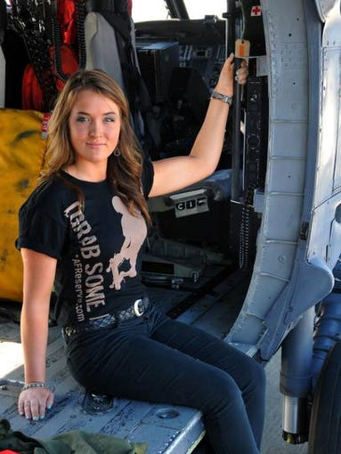 Courtney McCallan, of Merritt Island, will train to be the first female combat rescue pilot for the air force reserves. She is in a HH-60 Pave Hawk helicopter on the flight line at PAFB.
