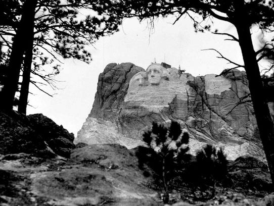 This 1933 photo shows the the beginning of work on Thomas Jefferson to the left of George Washington. The rock was deemed unfit to carve, and Jefferson was moved.