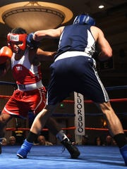 Nevada's Nate Strother, right, lands a blow against UCLA's Gabriel Samuels during the 2017 NCBA Western Regional Semi-Finals at the Eldorado Hotel & Casino in Reno on March 18, 2017.