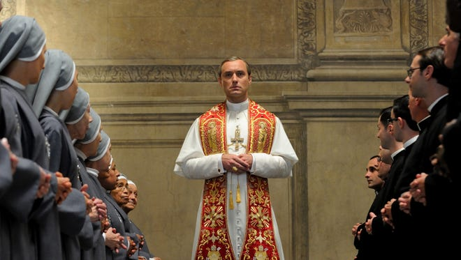 """This image released by HBO shows Jude Law from the HBO series, """"The Young Pope,"""" premiering Sunday at 9 p.m. EST. (HBO via AP)"""