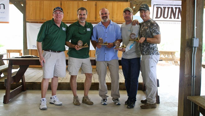 Greg Wheeler, left, with first place team of Richard Rhatigan, George McLain, Don Wood and Steven Parr at the Visiting Nurse Association of Florida's Charity Sporting Clay Shoot at Quail Creek Plantation on Oct. 21 in Okeechobee.