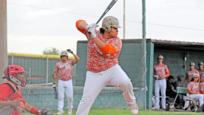 Artesia's Jharyss Granger looks to make contact at the plate in game one Friday at Roswell.