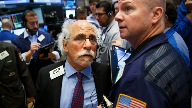 Traders on the floor of the New York Stock Exchange .