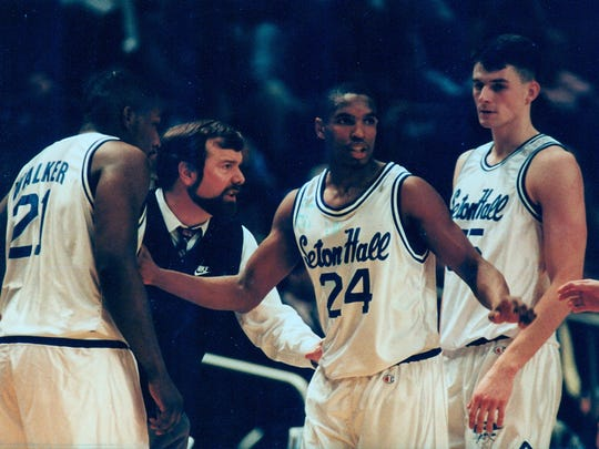 Seton Hall coach P.J. Carlesimo instructs Jerry Walker (left), Terry Dehere (24) and Arturas Karnishovas (right) during the 1992-93 season. That was the last Pirate team to reach the Preseason NIT final.