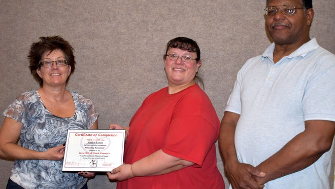 Leaders in Affirming Potential Cathy Underwood and Leonard Lewis present Jessica Lorett with her certification from Affirming Potential, one of the ministry courses Love INC offers.