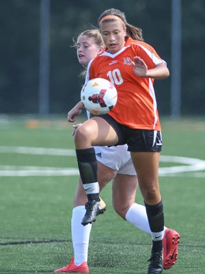 Hoover defender Lilly Tula leaps to stop a Canfield pass during Saturday's game.