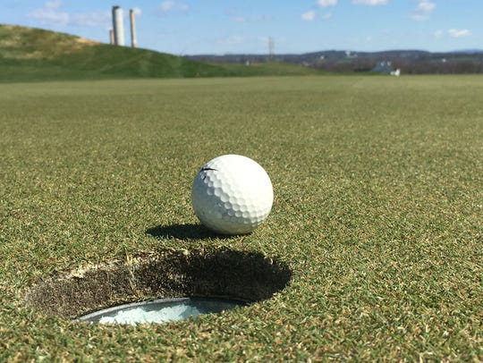 A ball rests near the hole on the par-4 5th green Tuesday