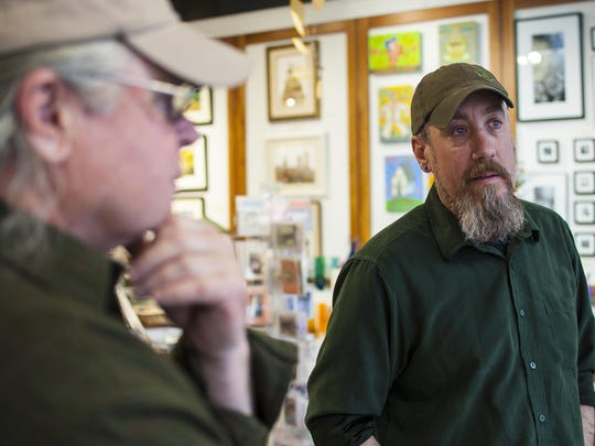 Veterans Joe English, left, and David Hurne discuss their experiences with the Green Mountain Chapter of Project Healing Waters Fly Fishing, which seeks to help disabled current and former members of the military deal with physical and emotional issues, at the Frog Hollow Vermont State Craft Center in Burlington on Thursday, May 5, 2016. Frog Hollow is hosting a fly fishing-themed exhibit to draw attention to the project.
