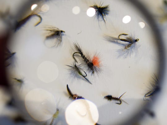 Fly-fishing lures tied by local veterans are seen through