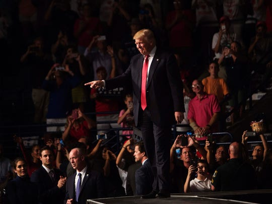 Donald Trump takes the stage at Germain Arena on Monday