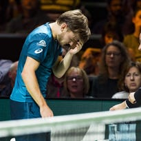 David Goffin out after ball hits eye, Grigor Dimitrov in Rotterdam final
