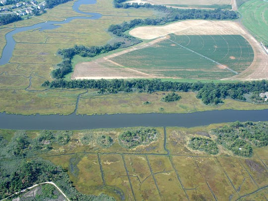 An aerial shot shows the 376-acre tract of state-owned land used by the Wolfe Neck Wastewater Treatment Facility and its proximity to waterways.