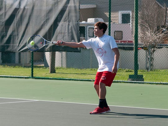 Port Clinton's Kyle Schultz hits the ball during a match with doubles partner Maxwell Brenner against Clyde at home on Thursday.