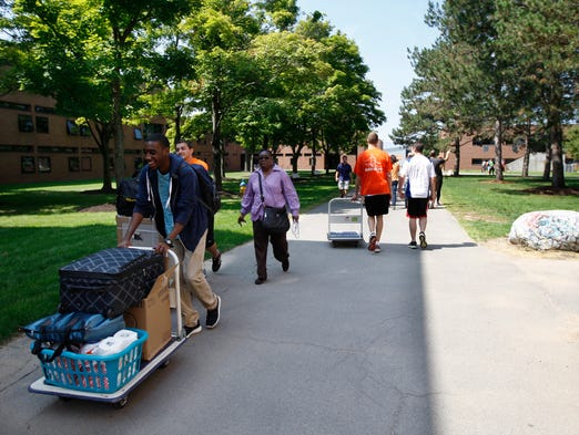 Freshman move-in day was held Aug. 19 at Rochester Institute of Technology in Henrietta. Daniel Roach, 18, of Brooklyn gets help with moving in from volunteer student Will Thurston and mom, Desire Siemple.