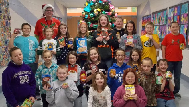 John Thompson's fifth-grade class tied with a third-grade class for collecting the most items for donation in the Mishicot Elementary School canned food drive and hat/scarf/mitten collection.