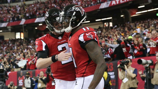 Atlanta Falcons wide receiver Julio Jones (11) scores a touchdown and is congratulated by quarterback Matt Ryan (2) during the third quarter against the Green Bay Packers  in the 2017 NFC Championship Game at the Georgia Dome.