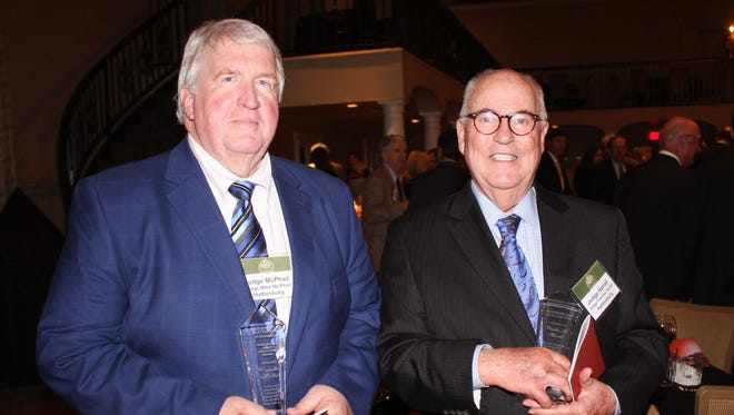 Forrest County Court and Youth Court Judge Michael W. McPhail, left, received the Bar Foundation's Law-Related Public Education Award on April 13. Circuit Judge Prentiss G. Harrell, right, was among 20 people inducted as Fellows of the Mississippi Bar Foundation.