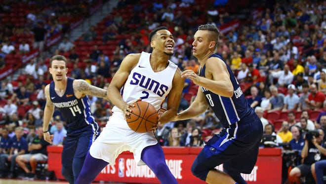 Jul 6, 2018; Las Vegas, NV, USA; Phoenix Suns guard Elie Okobo (2) drives to the basket against Dallas Mavericks guard Kyle Collinsworth (8) during an NBA Summer League game at Thomas & Mack Center.