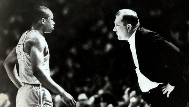 Former TWC and UTEP head coach talks with Willie Worsley during action in there game against Kentucky of the 1966 NCAA Basketball Tournament.
