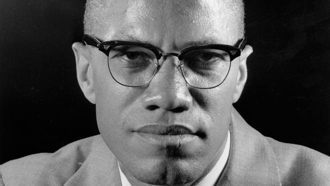 """Muslim leader Malcolm X poses during an interview in New York on March 5, 1964. One of the last major digital holdouts, """"The Autobiography of Malcolm X,"""" should soon be available as an e-book, the attorney for the late activist's estate told The Associated Press, Friday, Feb. 20, 2015."""