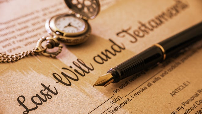 Vintage / retro style with a long shadow : Fountain pen, a pocket watch on a last will and testament. A form is printed on a mulberry paper and waiting to be filled and signed by testator / testatrix.