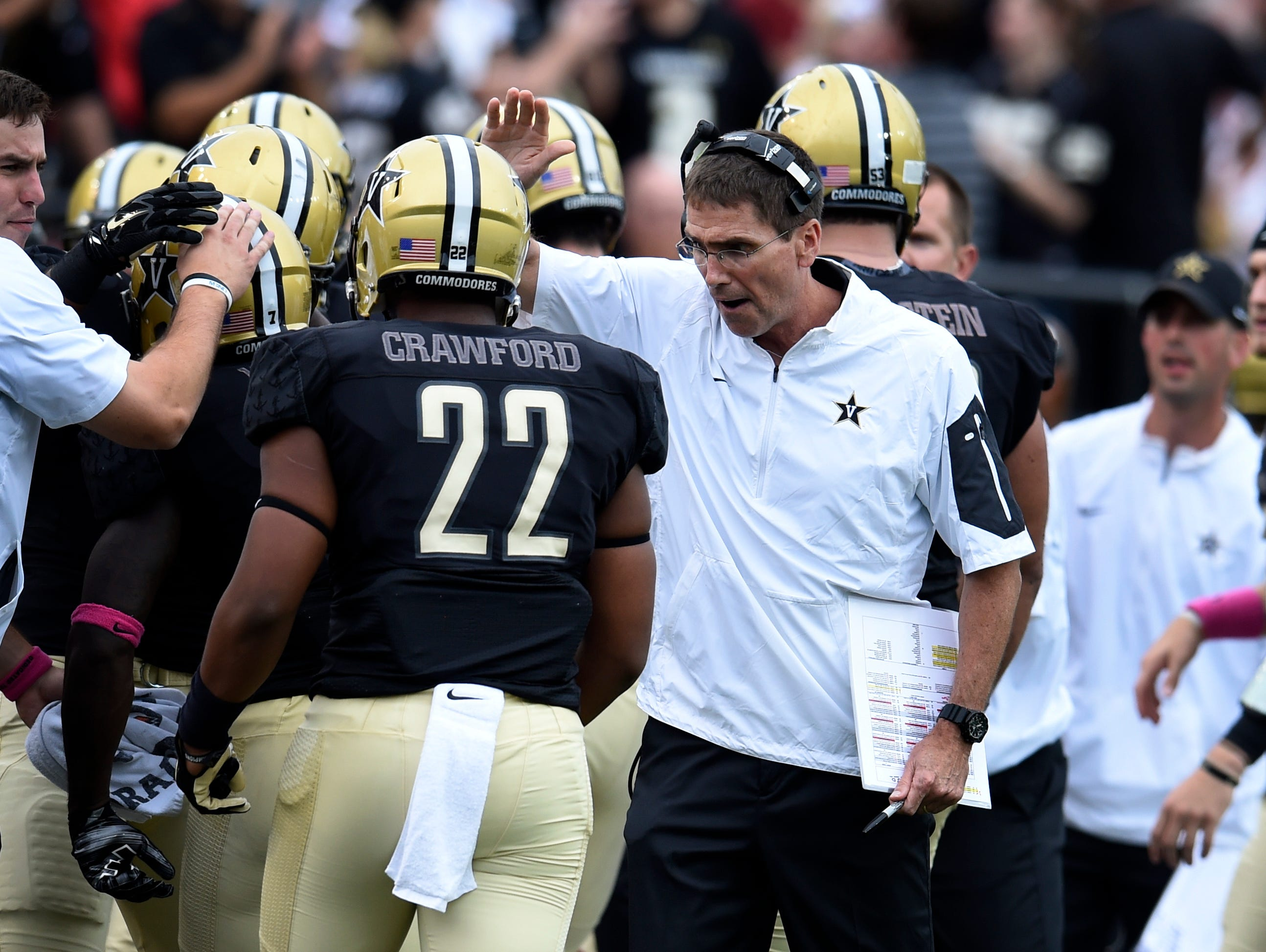 Vanderbilt offensive coordinator Andy Ludwig congratulates his players after the Commodores scored a touchdown during the second quarter against Missouri on Oct. 24, 2015.