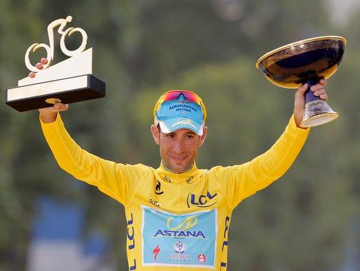 Vincenzo Nibali celebrates his Tour de France title on the podium.