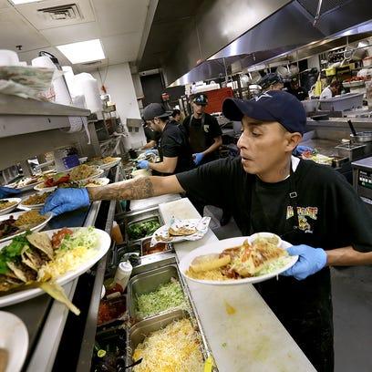 L&J Cafe cook Steve Sanchez works in the kitchen on