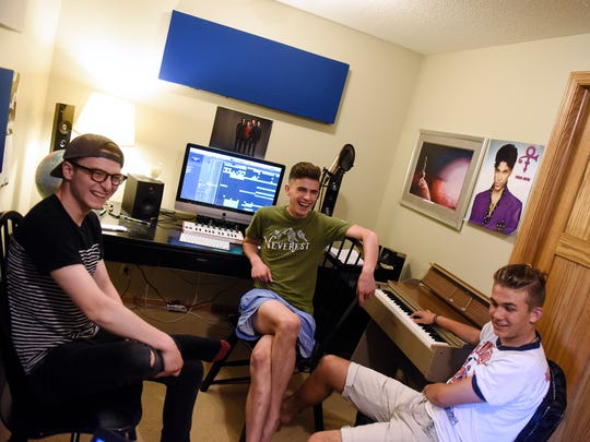 Isaac Hesse, left, Grant Hamilton, center, and Eddie Hamilton talk about their band Guytano during an interview Thursday, June 8, in Sartell.