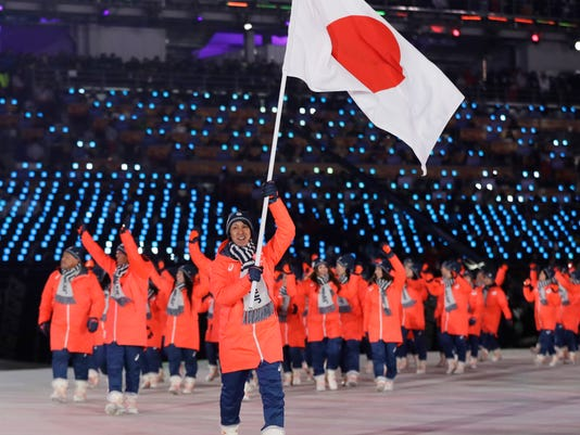 Noriaki Kasai carries the flag of Japan during the opening ceremony of the 2018 Winter Olympics in Pyeongchang, South Korea, Friday, Feb. 9, 2018. (AP Photo/Petr David Josek)