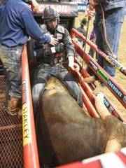 Tanner Byrne gets ready to ride during the Professional Bull Riders (PBR) Des Moines Invitational at Wells Fargo Arena on Sunday April, 26, 2015.