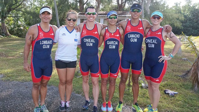 The Guam national triathlon team will compete at the 2015 Pacific Games in Papua New Guinea in July. The team includes, from left, Peter Lombard, team manager Rose Munoz, Cameron O'Neal, Mylene Garcia, Patrick Camacho and Karly O'Neal. Ayshalynn Perez is not pictured.