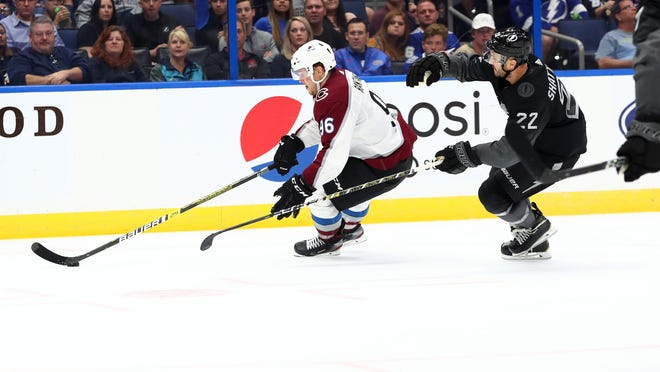 Oct 19, 2019; Tampa, FL, USA; Colorado Avalanche right wing Mikko Rantanen (96) skates with the puck as Tampa Bay Lightning defenseman Kevin Shattenkirk (22) defends during the second period at Amalie Arena. Mandatory Credit: Kim Klement-USA TODAY Sports