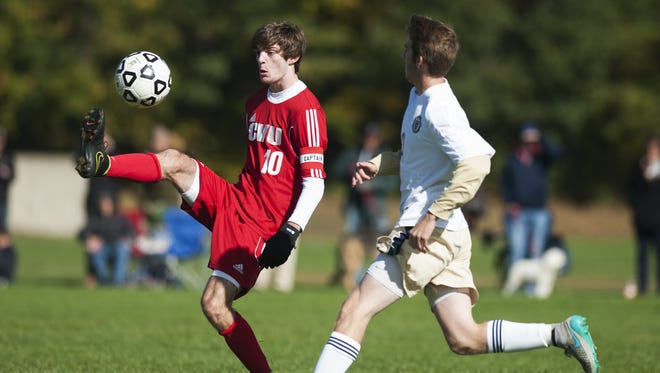 CVU's Cooper O'Connell (10) kicks the ball during a high school boys soccer game earlier this season. O'Connell and the Redhawks will enter the postseason as the No. 1 seed.