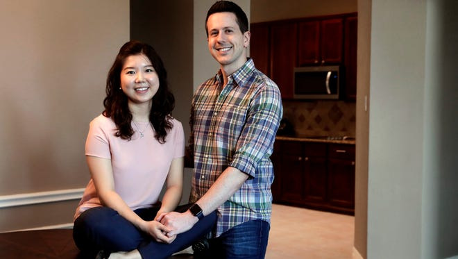 Rob Chilton and his wife Saria pose for a photo in their recently purchased home in Frisco, Texas. To cope with rising prices in Dallas, first-time buyers like Rob Chilton and his wife have broadened their search area, even if it lengthens their commutes to work. The couple, who cut back on dining out and other luxuries the past few years to set aside money for a down payment, bought a three-bedroom, two-bath fixer-upper for $335,000 in February.