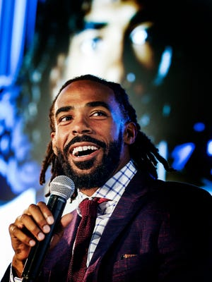 Memphis Grizzlies guard Mike Conley attends a press conference for the unveiling of three new Nike uniforms that included FedEx as the team's first-ever jersey sponsor. The Grizzlies will also have two new courts at FedExForum with a reimagined logo.