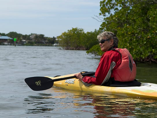 Former Martin County Commissioner Maggy Hurchalla kayaks