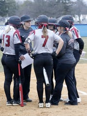 Elmira coach Becca Saggiomo talks to her players during