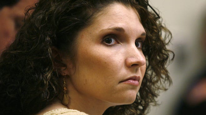 Melanie McGuire listens to testimony during her murder trial on March 27, 2007.