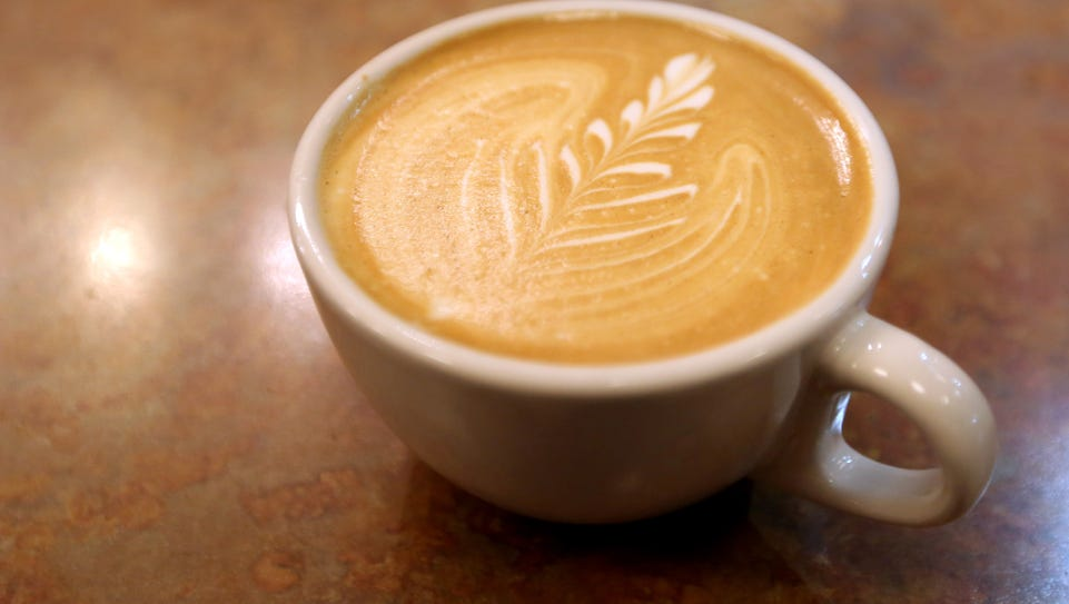 A latte served at the The Governor's Cup Coffee Roasters