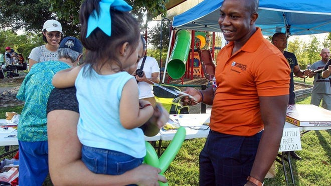 Pflugerville City Council Member Rudy Metayer meets residents during National Night Out last year.