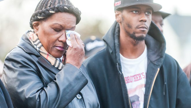 Pamela White, mother of the late Philip White, wipes a tear away as a prepared speech was given by Pastor James Dunkins at Fourth St. and Grape St. in Vineland on Thursday, December 8.