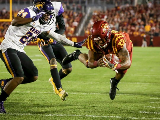Iowa State Cyclones running back David Montgomery (32) dives in for a second quarter touchdown against Northern Iowa at Jack Trice Stadium in Ames, Iowa, Saturday, Sept. 2, 2017.