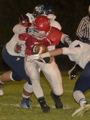 Senior Ezra Emme fights for extra yardage in a game against Bay Port last season.